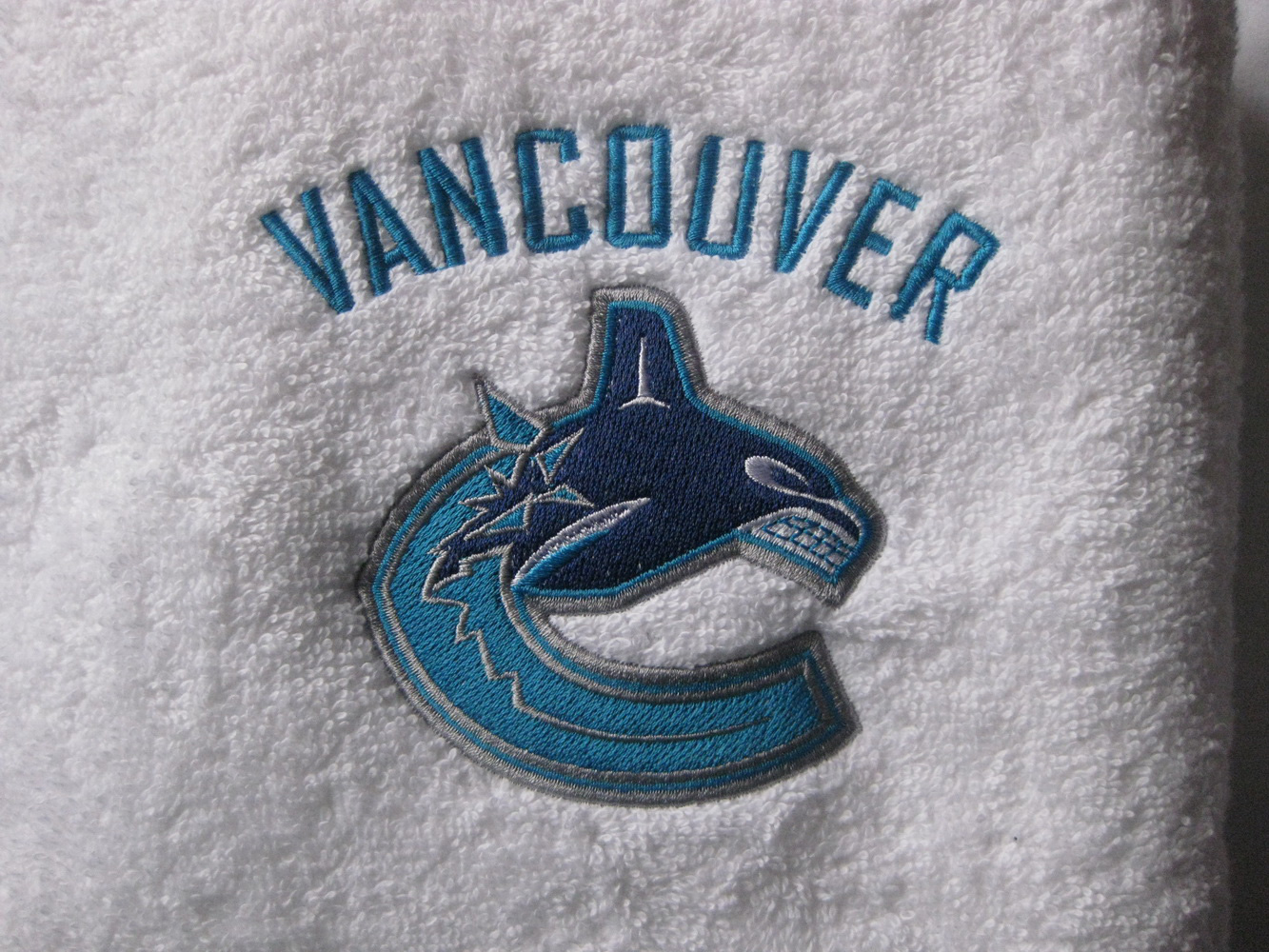 Vancouver Canucks logo on towel
