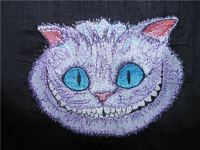 Embroidered Cheshire cat design