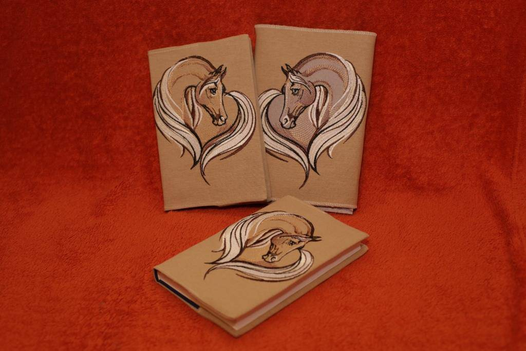 Book cover with horse embroidery design