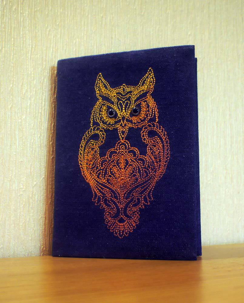 Embroidered cover with owl