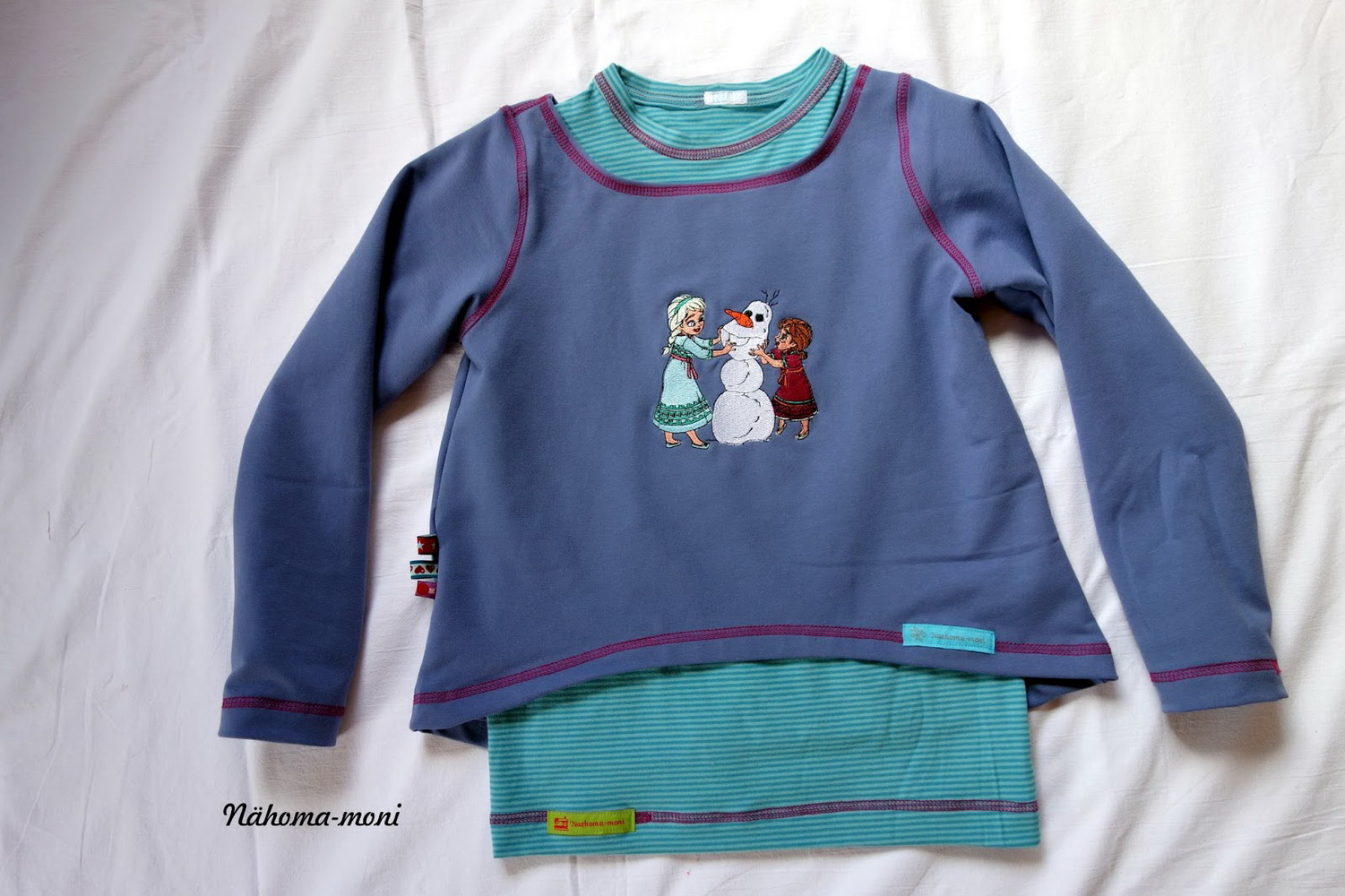 Blue shirt with embroidered Making snowman design