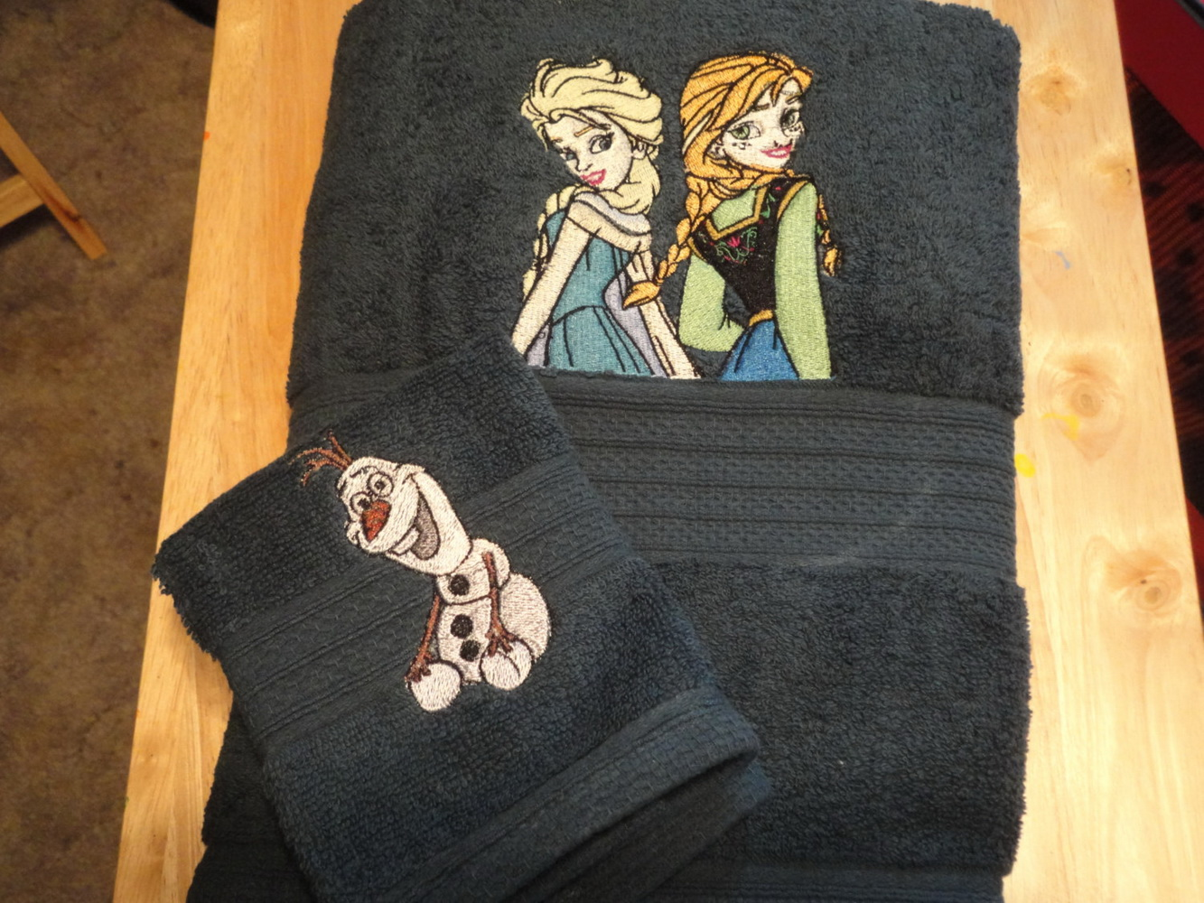 Anna, Elsa and Olaf embroidered on black towels
