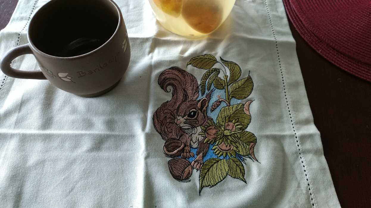 Napkin with squirrel with hazelnut embroidery design