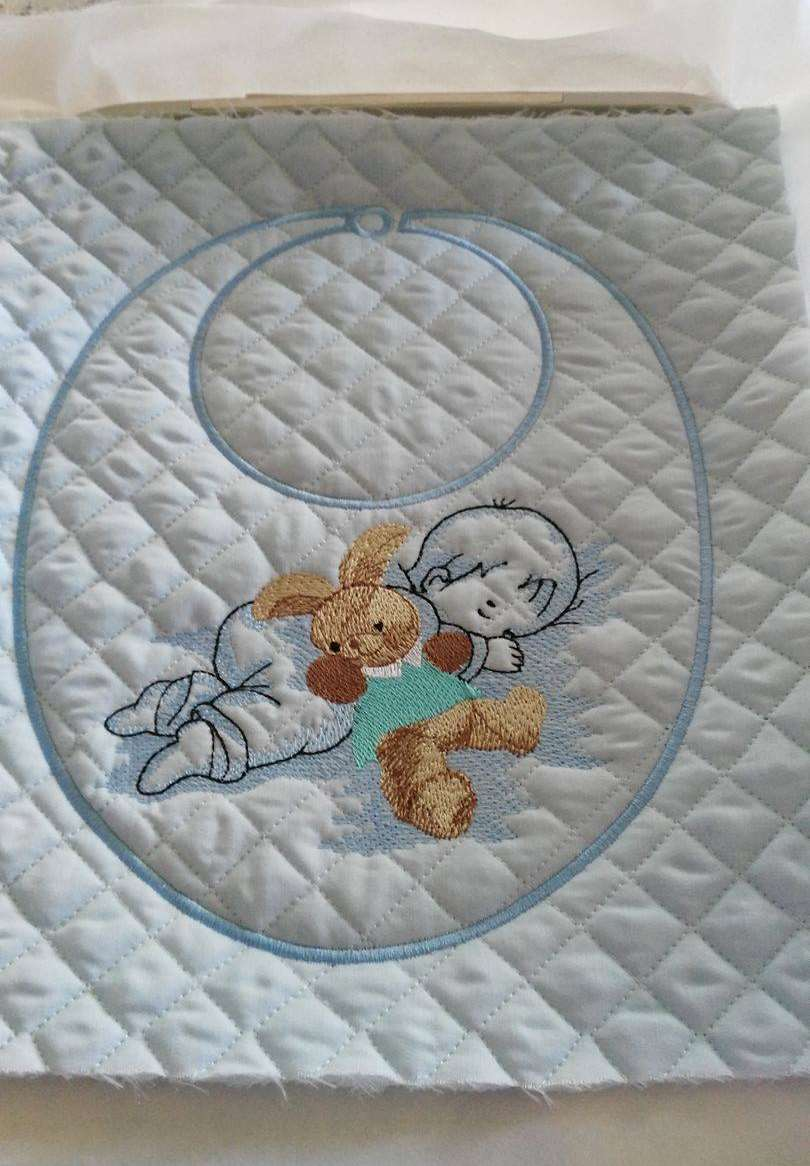 Baby bib with Sleeping baby and toy embroidery design