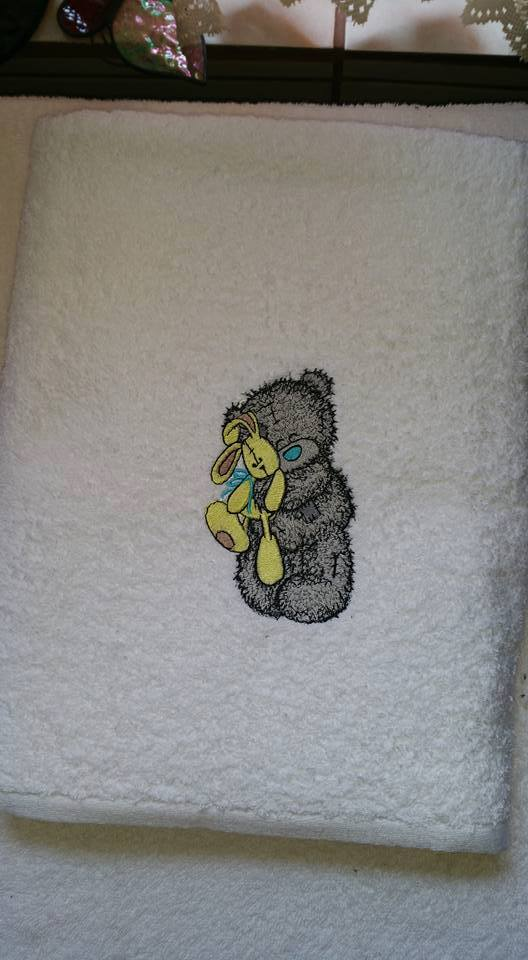 White bath towel with Teddy Bear with toy embroidery design