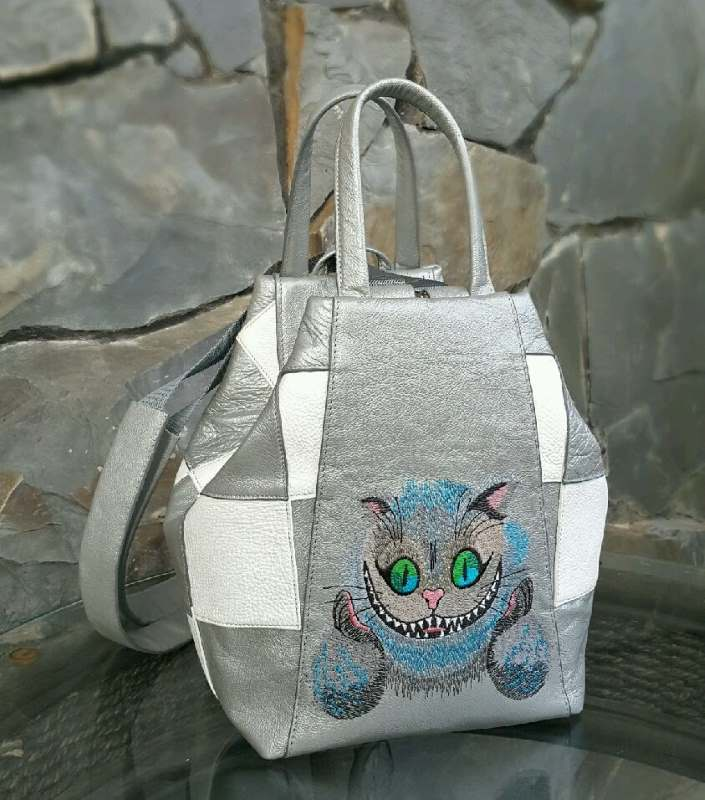 Handbag with Cheshire cat embroidery design
