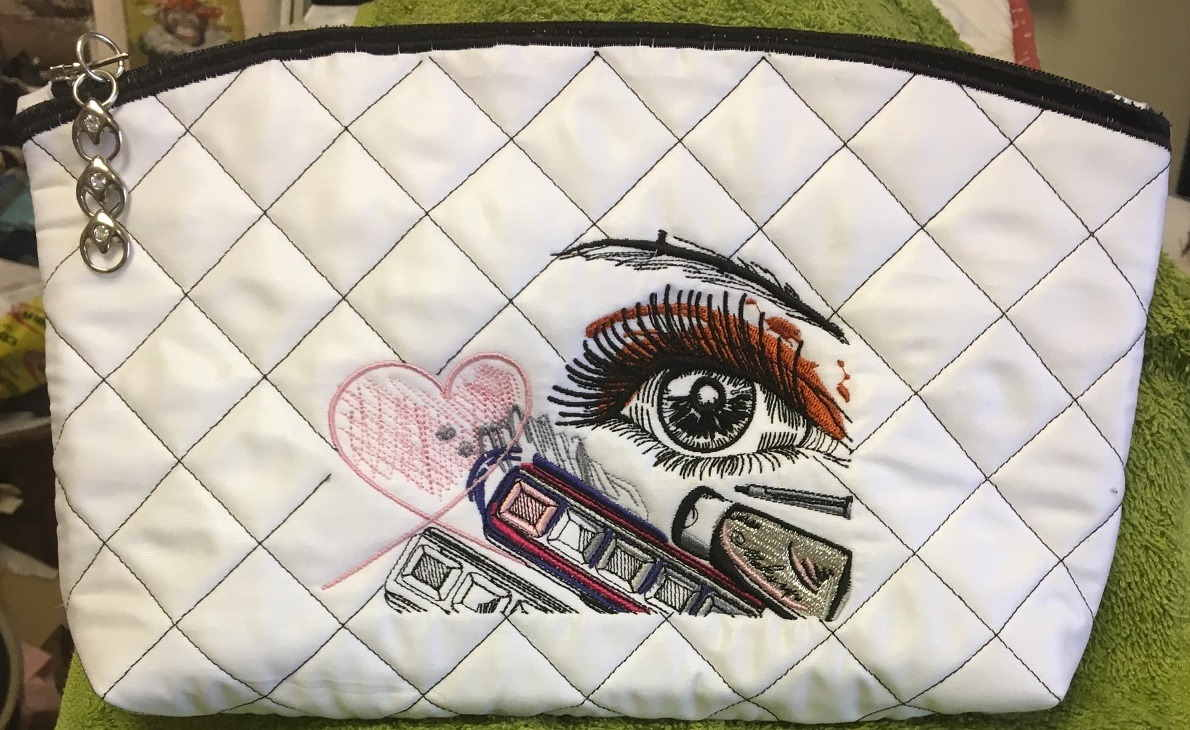 Embroidered beauty bag with fashion look design
