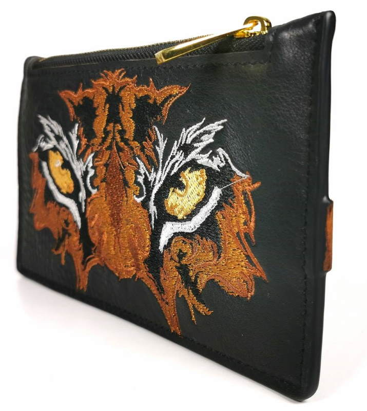 Embroidery beauty bag with tiger eyes design