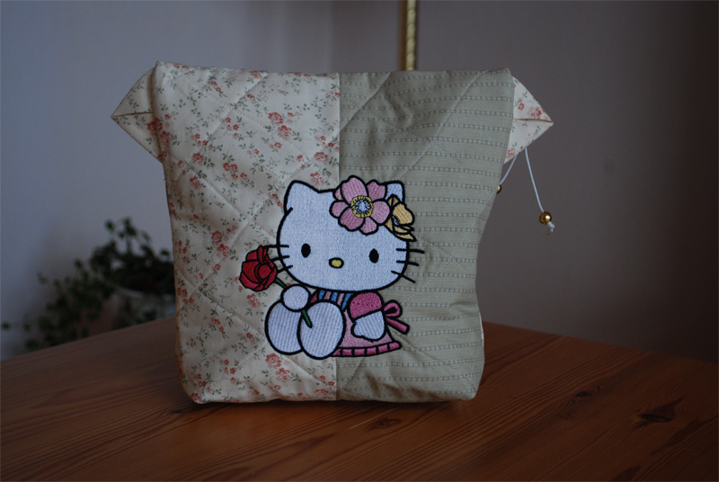 Hello kitty with rose design on embroidered beige bag