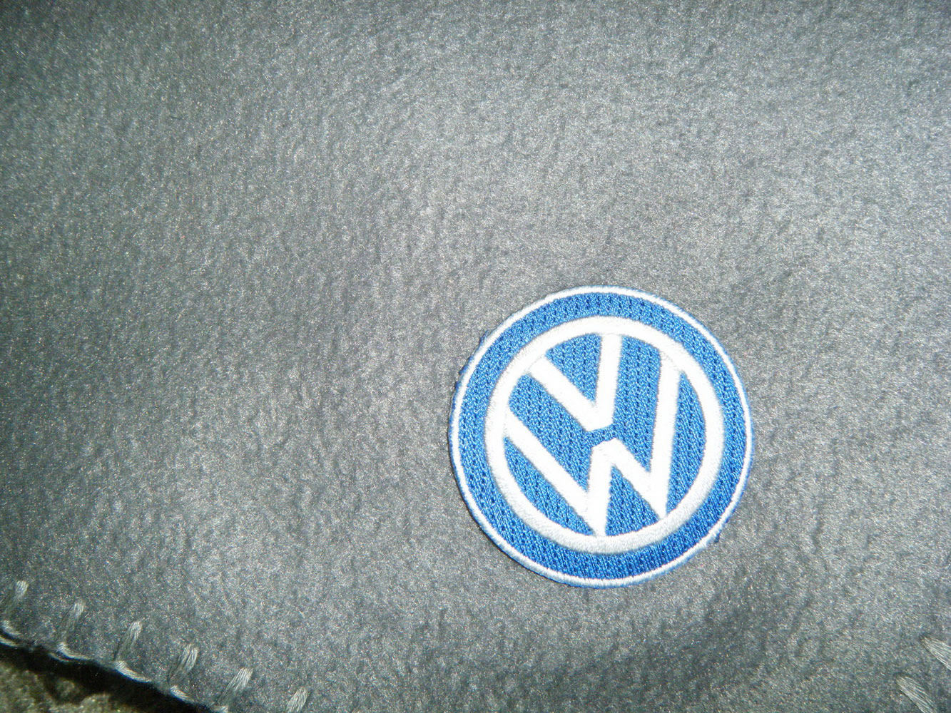 Embroidered Volkswagen logo on blanket