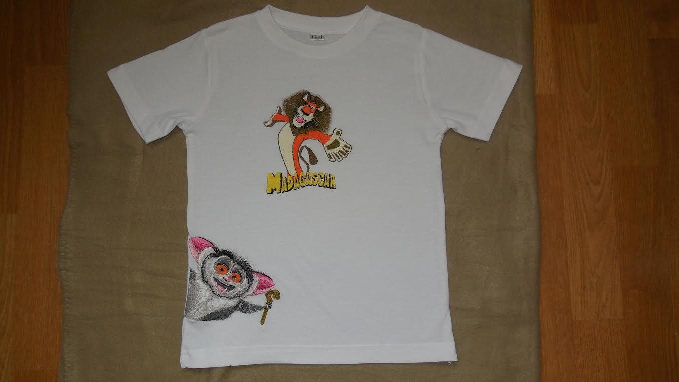 Embroidered lion and monkey on t-shirt