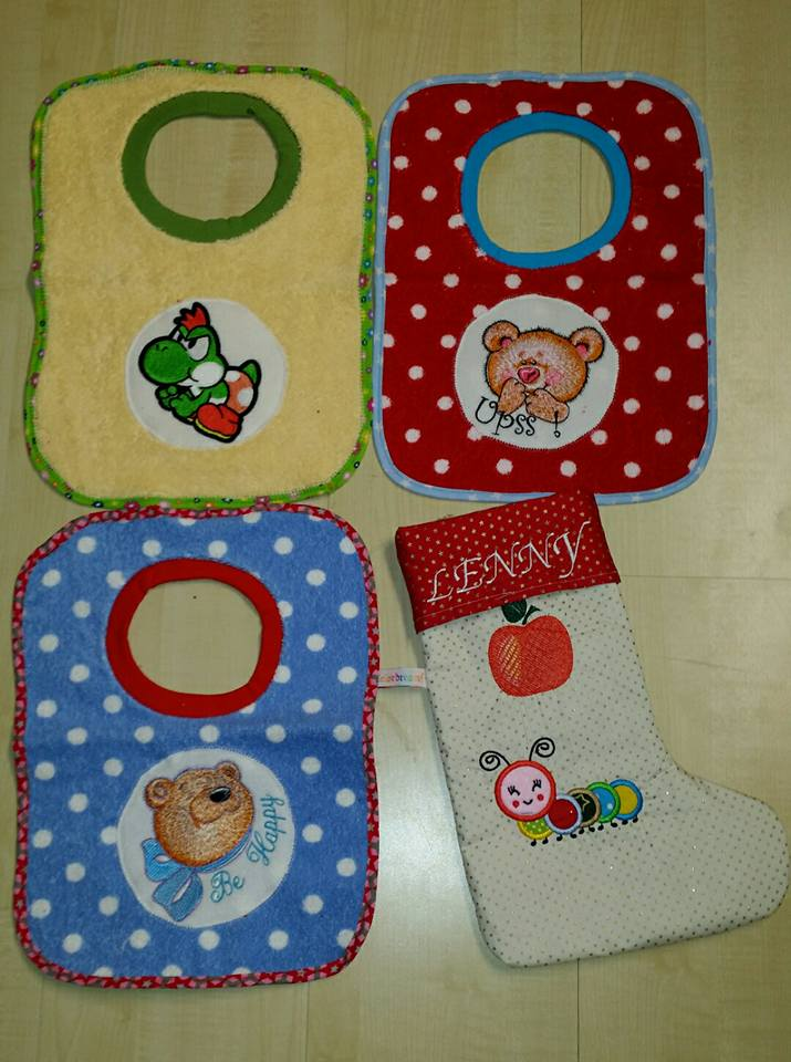 Yoshi and teddy bears embroidered on baby bibs