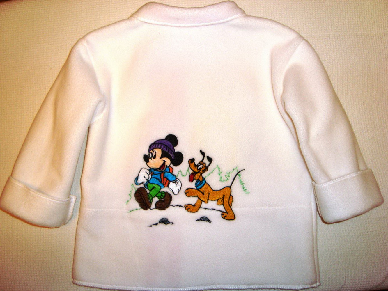Mickey Mouse and Pluto embroidered on jacket
