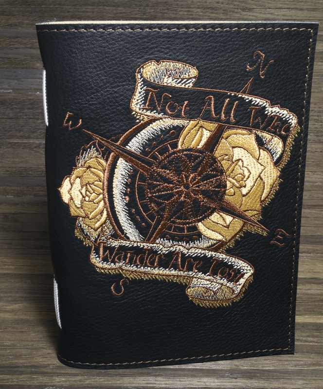 Embroidered leather cover for notepad