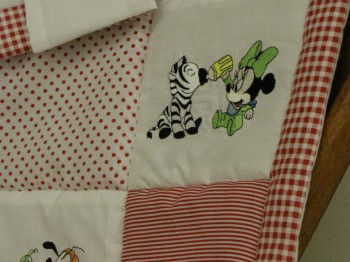 Embroidered quilt with Minnie mouse and zebra