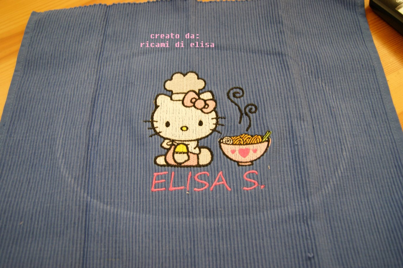 Hello Kitty loves chinese food on embroidered purple towel