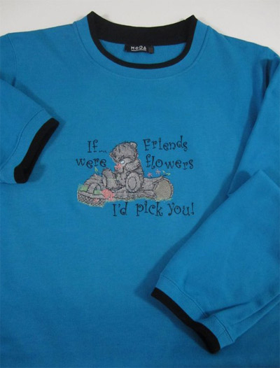 Teddy bear with a basket of flowers design on embroidered shirt