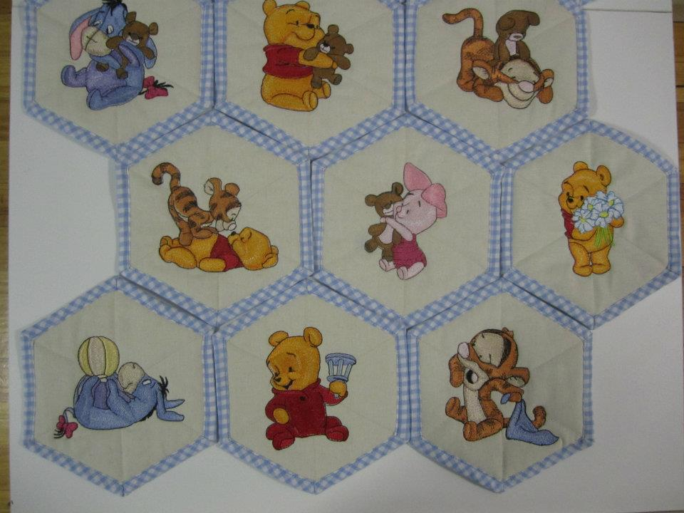 Baby quilt embroidered with baby Pooh and friends designs