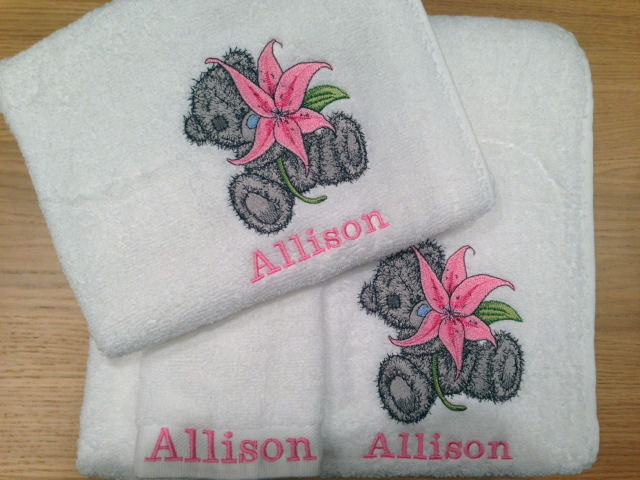 White towel embroidered with teddy bear with lily design