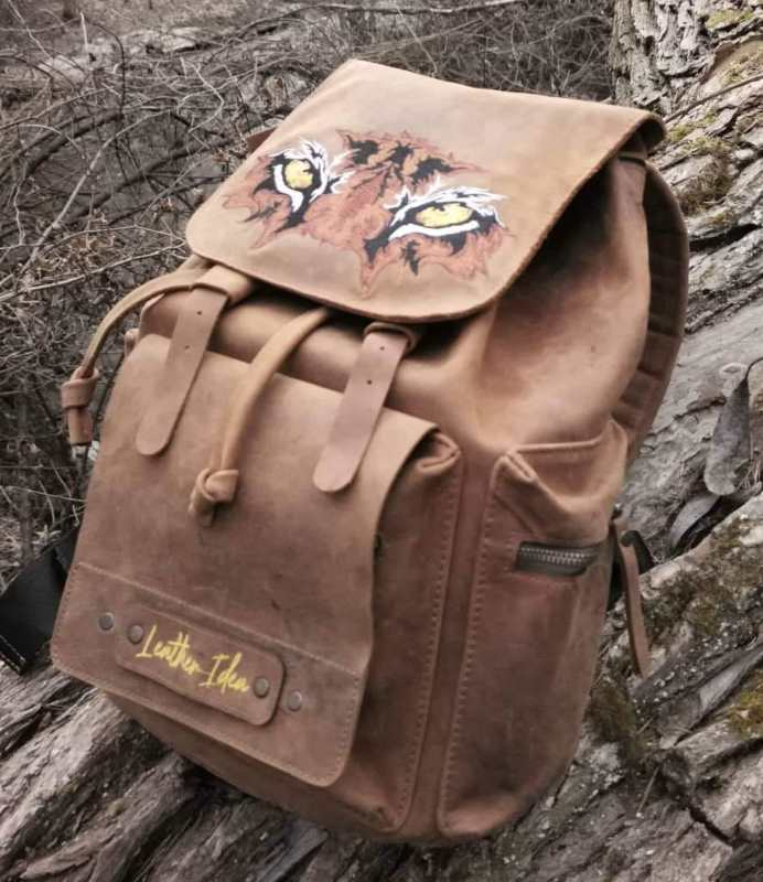 Leather backpack with tiger muzzle embroidery design