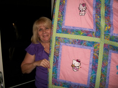 Warm quilt with Hello Kitty embroidered on it