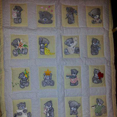 Cute baby quilt with embroidered teddy bears