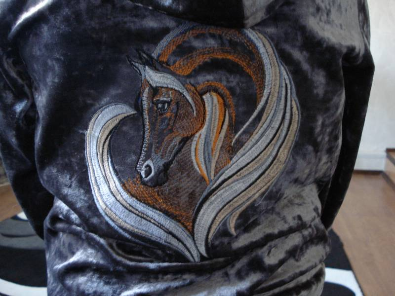 Black jacket embroidered with horse design