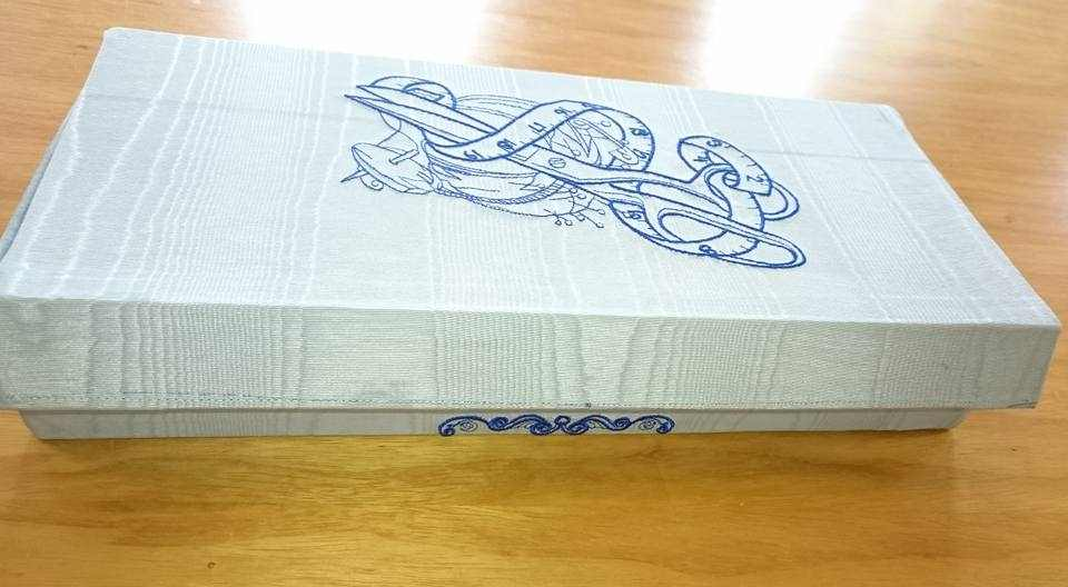 Sewing box with scissors measure and needle bar embroidery design