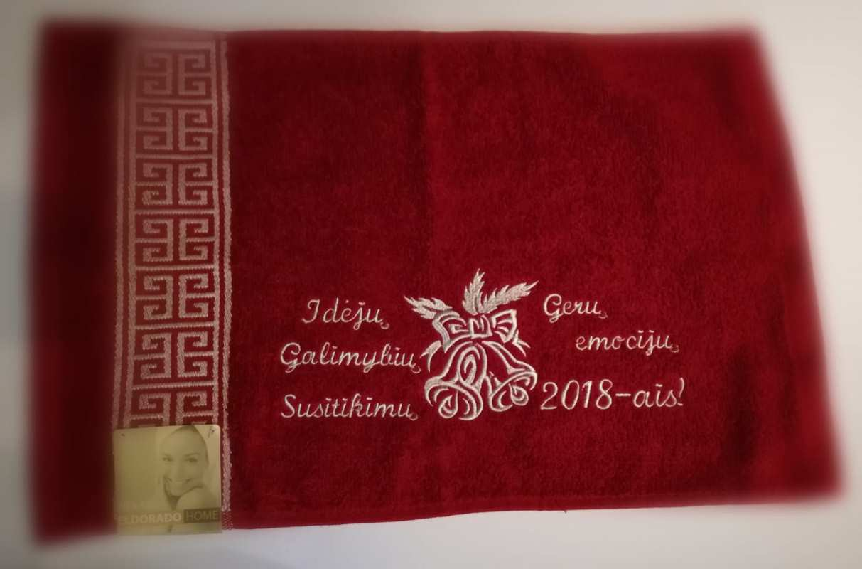 Dark red towel with Christmas bell free embroidery design