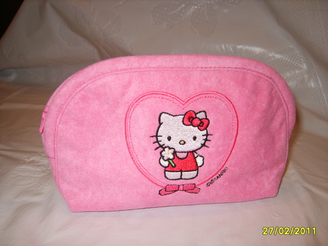 Hello Kitty embroidered on pink cosmetic bag