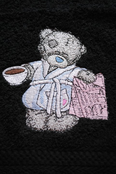 Black towel embroidered with tatty teddy design