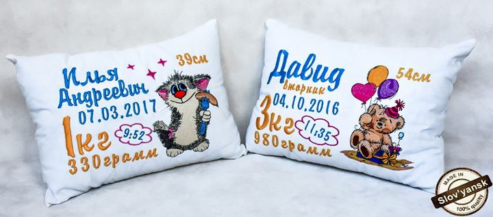 Two cushions with cartoon embroidery designs