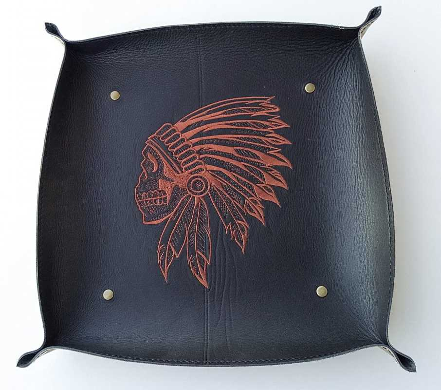 Leather table item embroidered with indian skull design