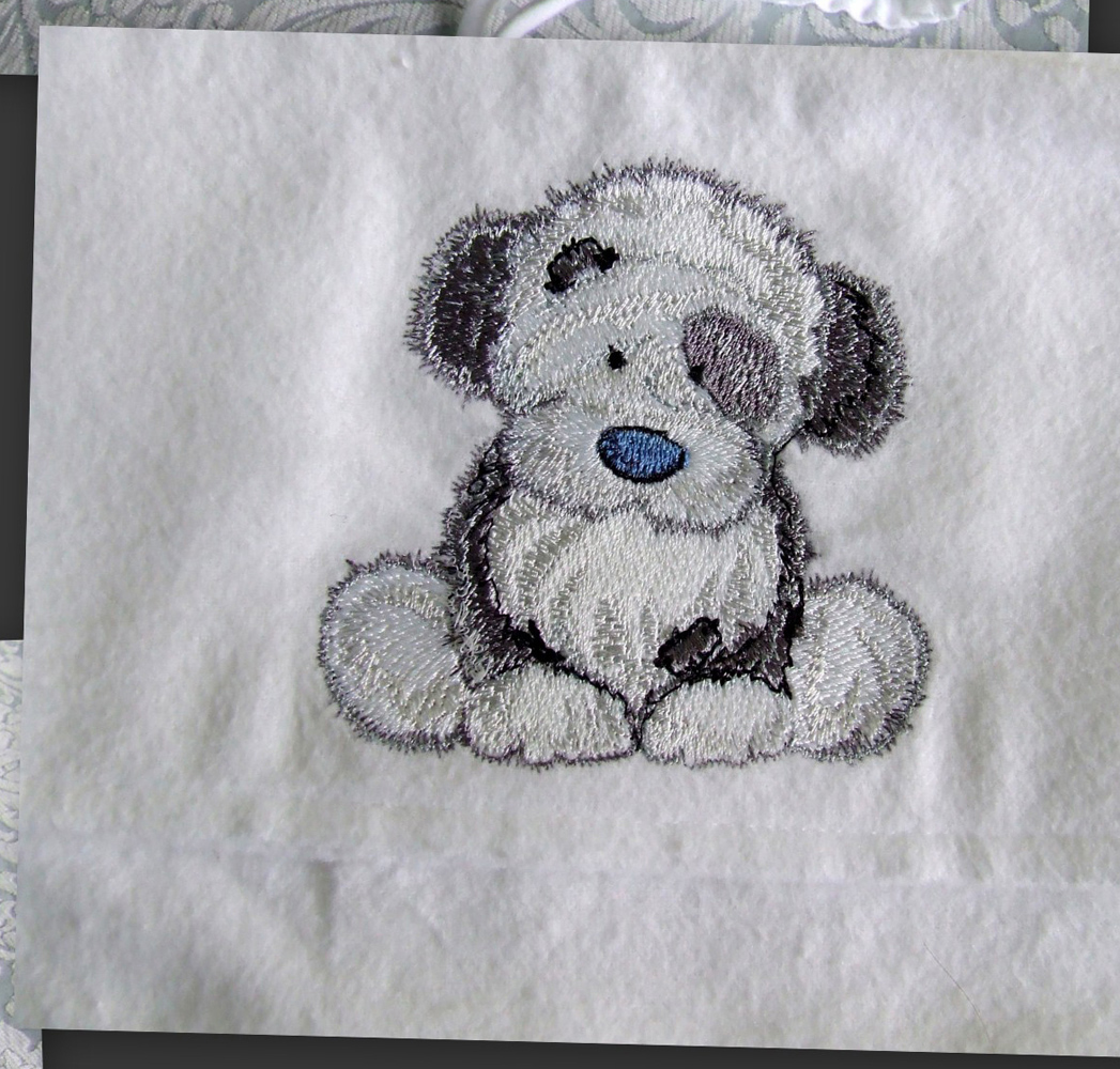 Towel with dog embroidered on it