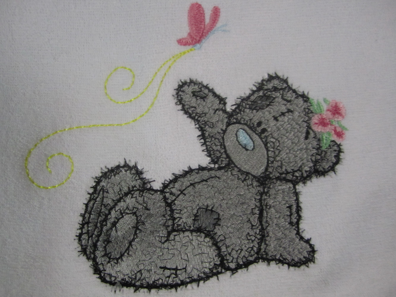 Baby bib embroidered with butterfly and teddy bear