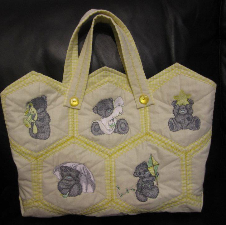 Teddy bear designs embroidered on nappy bag