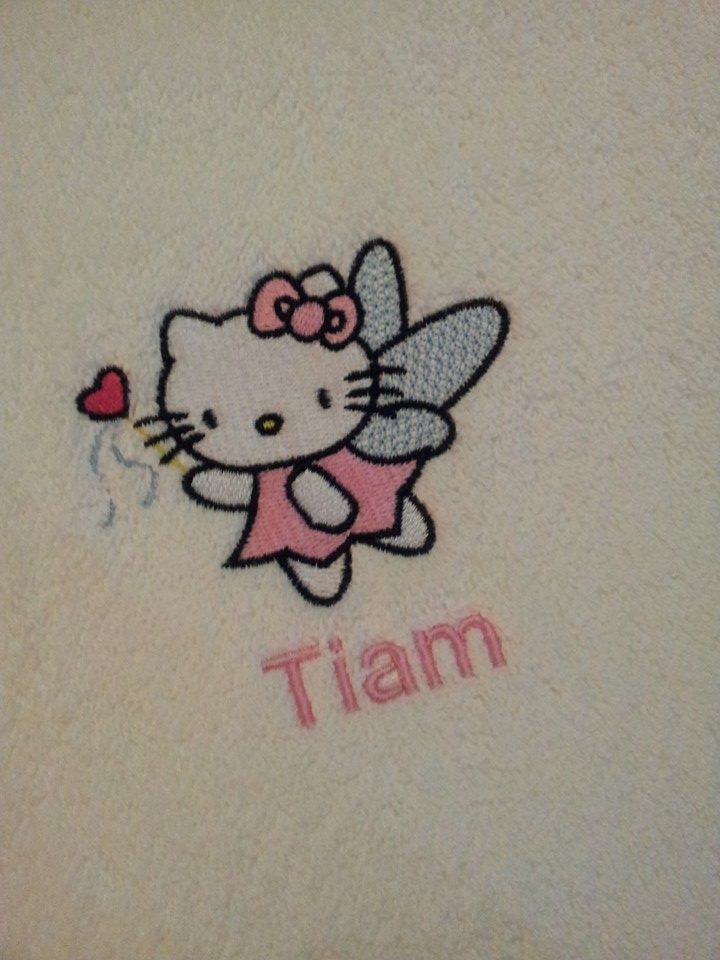 Embroidered Hello kitty fairy design on towel