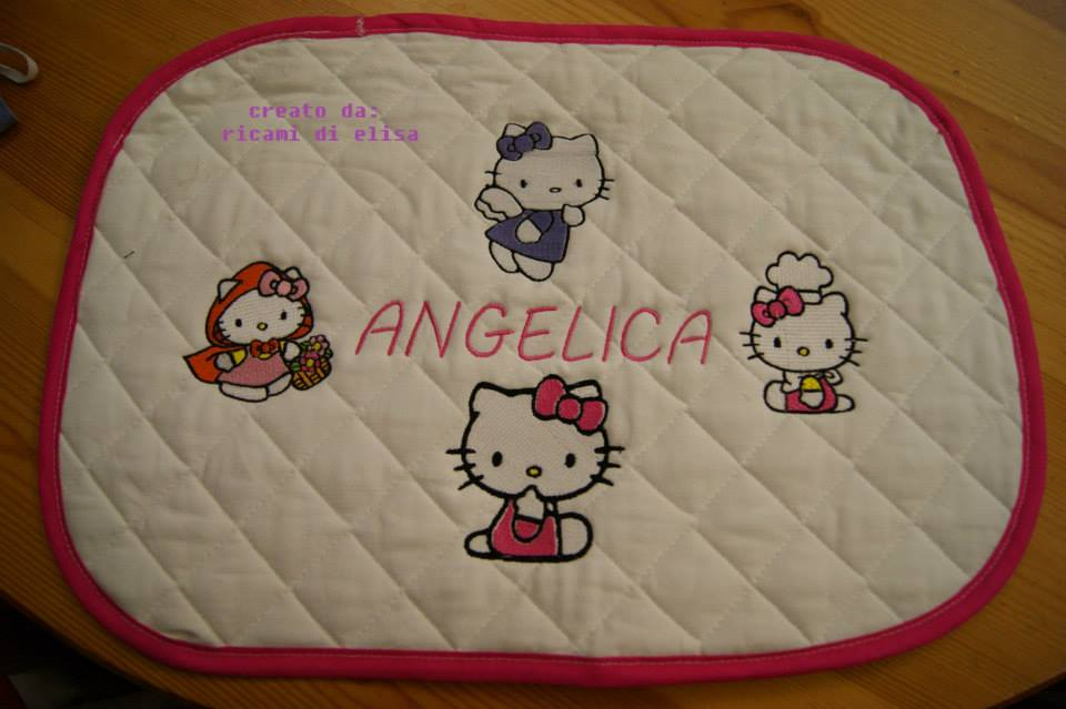 Embroidered Hello Kitty designs on potholder