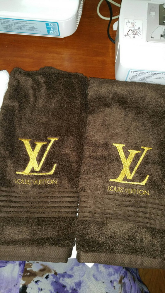 Embroidered Louis Vuitton logo on towel