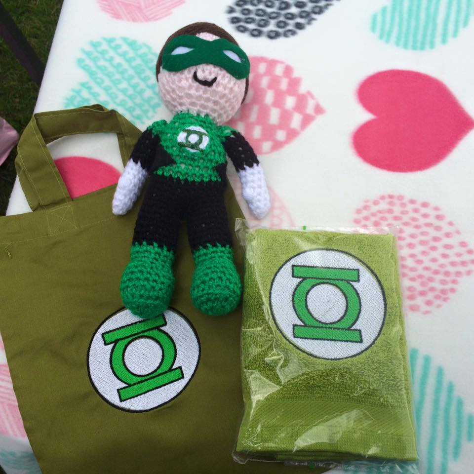 Green Lantern logo embroidered on bag and towel