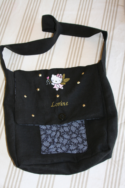 Black embroidered bag with Hello Kitty design