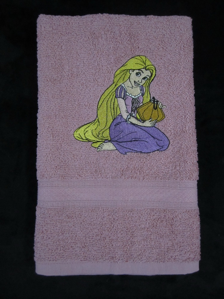 Embroidered towel with Rapunzel on it