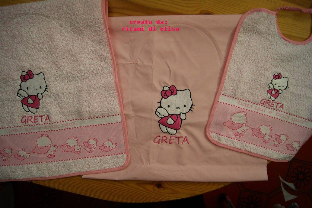 Hello Kitty Happy Angel design embroidered on towel and bib