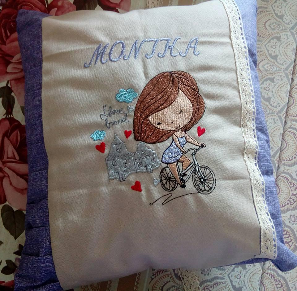 Cushion with travel girl embroidery design