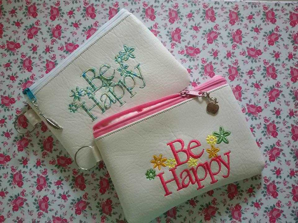 Cosmetic bag with be happy free embroidery design