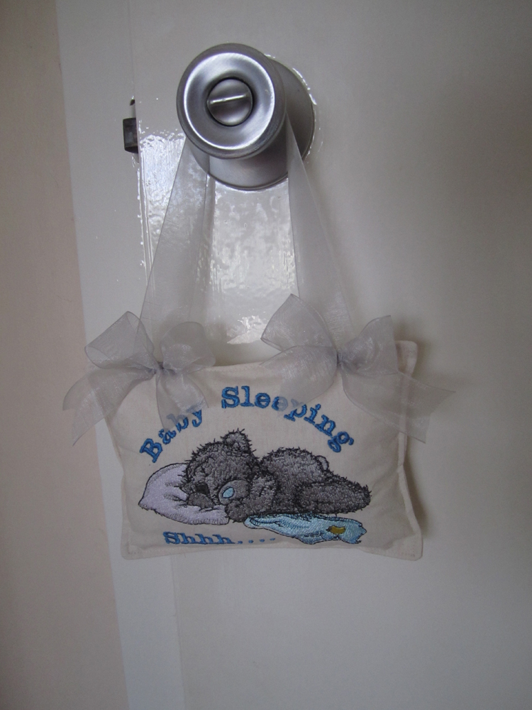 Blue nose tatty teddy embroidered on baby nursery door hanger