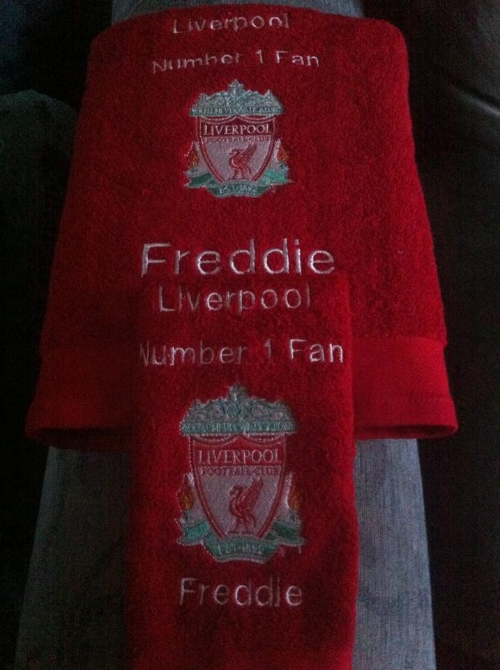 Embroidered bath towel with Liverpool Football Club logo on it