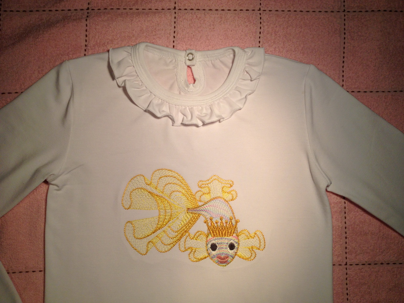 Gold fish embroidered on shirt