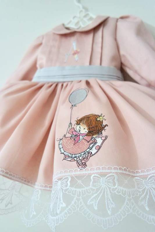Embroidered dress with girl birthday design