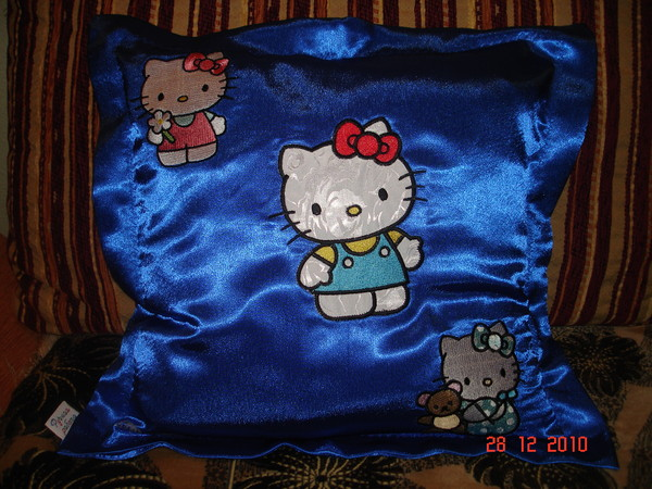 EmbroideredHello Kitty designs on pillowcase